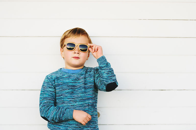Young boy pediatric holding eyewear